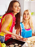 Girl baking cookies in the oven Stock Photography