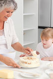 Girl baking with her grandmother Royalty Free Stock Photos
