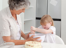 Girl baking with her grandmother Royalty Free Stock Images
