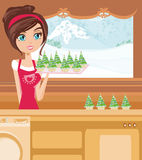 Girl Baking muffins in christmas style Stock Photos