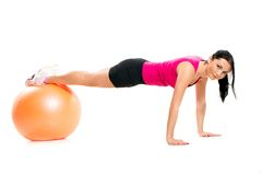Girl balance on the ball Stock Photography