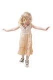 Girl balancing. Little girl balancing isolated on withe Stock Photo