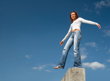 Girl balancing above a precipice-1. Balance Royalty Free Stock Photo