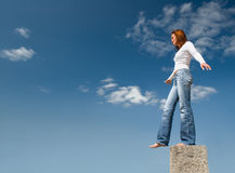 Girl balancing above a precipice-2. Balance Royalty Free Stock Photography