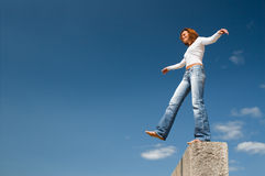 Girl balancing above a precipice-3 stock photos