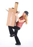 Girl balancing with cardboard boxes stock photos
