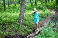 Girl balancing on a log Stock Photo
