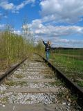 Girl  balancing on rail Royalty Free Stock Images