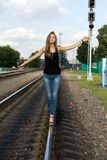 Girl balancing on rails Stock Photos