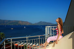 Girl on the balcony. Girl on the hotel balcony royalty free stock photo