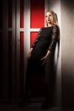 Girl on balcony in black dress Royalty Free Stock Photo