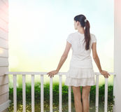 Girl on balcony Stock Photo