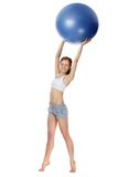 Girl with a ball. Portrait of a young girl holding gymnastic ball Royalty Free Stock Photos