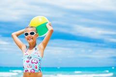 Girl with ball on the beach Stock Photos