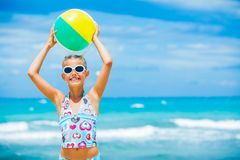 Girl with ball on the beach Stock Image