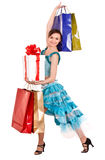 Girl in ball dance dress with gift box, shop bag. Royalty Free Stock Photography