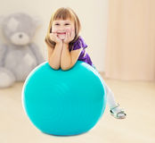 The girl with the ball for fitness Stock Photography