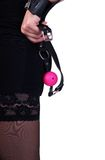 Girl with a ball gag. Girl holding a pink ball gag. focus on hands with a gag Royalty Free Stock Photo