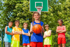 Girl with ball and international friends behind Royalty Free Stock Images