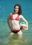 Girl with ball in lake Royalty Free Stock Photos