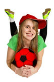 Girl with ball lie prone Stock Images