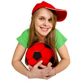 Girl with ball lie prone. Isolated on the white Royalty Free Stock Photos