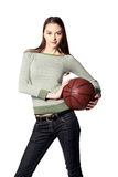 Girl with ball looking ahead. Girl with ball in hands looking ahead Royalty Free Stock Photo