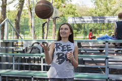 Girl with ball. Girl playing with a ball on the basketball court Royalty Free Stock Photo