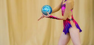 Girl with a ball on a professional gymnast .Flexibility in acrob royalty free stock image
