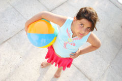 Girl with ball on sidewalk Stock Photos
