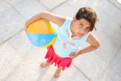 Girl with ball on sidewalk Stock Photos