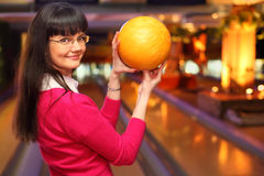 Girl with ball stands in bowling club Stock Image