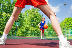 Girl with ball view between two legs of player Royalty Free Stock Photo