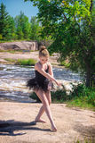 Girl Ballerina Posing Outside by River Stock Images