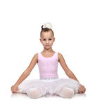 Girl ballerina sitting on floor Royalty Free Stock Image