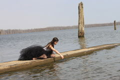 Girl in Ballerina Skirt on Dock Stock Photography