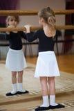 Girl at ballet barrel. Ballet pas. Stock Images