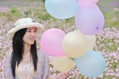 Girl with ballons Stock Photos