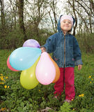 Girl with ballons. Little girl with multicolored  ballons Royalty Free Stock Image