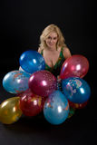 Girl with ballons. On black background Stock Images