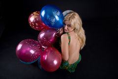 Girl with ballons. On black background Royalty Free Stock Image