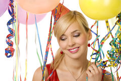 Girl between ballons and ribbons Stock Photos