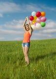 Girl with Ballons Stock Image