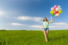 Girl with Ballons Stock Images