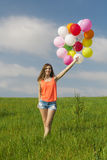 Girl with Ballons Stock Image
