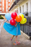 Girl with ballons Royalty Free Stock Image