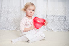 Girl with balloon Stock Images