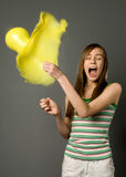 Girl and balloon. The girl pierces a pin a balloon (high speed photography stock photos