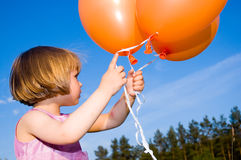 Girl with a balloon Royalty Free Stock Image