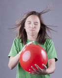 Girl and balloon blast. Stock Photo